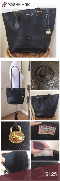 """VINTAGE DOONEY & BOURKE SMALL BUCKET BAG Gently worn and one of my favorite bags. Black on Black. Clean interior and exterior.  Minor scuffs on the bottom of the bag from normal use. Normal surface scratches and tarnish to the hardware.  Pebbled All-Weather Leather Has a long key strap inside with brass trigger snap. Brass duck fob. No rips or tears. SERIAL #A7 677983. MEASUREMENTS ARE APPROXIMATE:  Length: 13.0""""at top, 10.0"""" at base Height: 10.5"""" Width (depth at the base) 6.0"""" 🚫TRADES🚫…"""