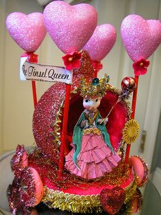 Oh how I want this-she's labeled the tinsel queen. I can even get over my distaste of heart-shaped things for this. Believe Lisa Kettell is the artist.