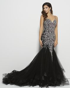 This Mac Duggal dress is pure luxury! Imagine walking into prom in this dress! Head will be turning! Style 82517M Black