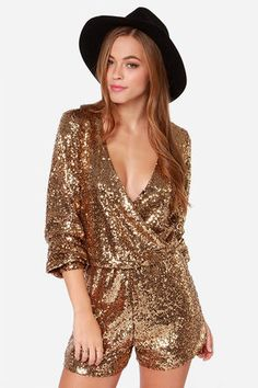 "Have your outfit shine as bright as your personality in the Good as Gild Gold Sequin Romper! Bright gold sequins sparkle over this long sleeve romper with a surplice bodice that secures with a single snap below the deep V neckline. Long sleeves have fitted cuffs. Elastic waistband. Romper is fully lined. Model is 5'8"" and wearing a size small. 100% Polyester. Hand or Machine Wash Cold. Imported."