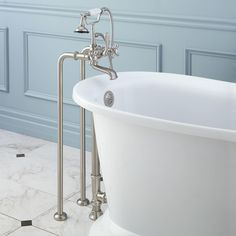 This stylish Victorian bathroom faucet features variable - centers and metal cross handles with porcelain insets.This faucet comes with a brass lift-rod drain. Mobile Home Bathroom, Tub, Bathroom Sink Faucets, Stand Alone Bathtubs, Tub Faucet, Freestanding Tub Faucet, Bathtub Faucet, Bathtub Drain, Freestanding Faucets