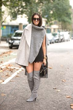 It's all about that flash of leg. Soft, gray layers are cozy, but the peek of skin is what dials this outfit up to 11.