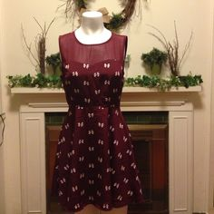 Maroon and cream bow pattern dress size medium Maroon and cream bow pattern dress. Forever 21 brand. Size medium. The top is a sweat heart design that is sheer. 100% polyester. Forever 21 Dresses Midi