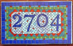 House number with colors inspired by founder of the Bauhaus School in Germany, Walter Gropius' house in Lincoln, MA. Description from bigbangmosaics.com. I searched for this on bing.com/images