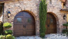 Tuscan style garage doors in a rustic European design. Gorgeous stain & rustic dummy hardware with some distressing on the wooden surface! Tuscan Style Homes, Mediterranean Style Homes, Spanish Style Homes, Tuscan House, Spanish House, Spanish Colonial, Custom Garage Doors, Wood Garage Doors, Garage Gate