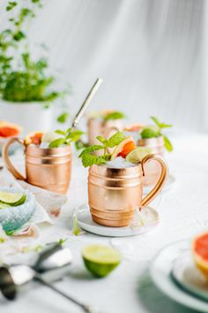 This recipe is a variation on classic Moscow mules! These copper mugs are filled with fresh grapefruit juice and topped with sparkling ginger beer. These cocktails are perfect for spring holidays! Spring Cocktails, Refreshing Cocktails, Classic Cocktails, Yummy Drinks, Vodka Cocktails, Dinner Party Recipes, Cocktail Recipes, Gimlet Recipe, Moscow Mule Recipe