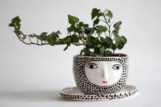 One of a kind hand built polka dot planter with sculpted face. This planter has drainage holes, it comes with the plate. Measures Heigh: 7.5 cm
