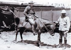 Winston Churchill (on the pony) by the wrecked railway trucks of the Armoured Train at Chievely on November 1899 during the Boer War