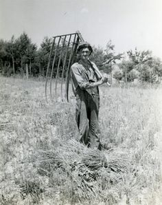 Antique photo, 19th century farmer with hay rake.