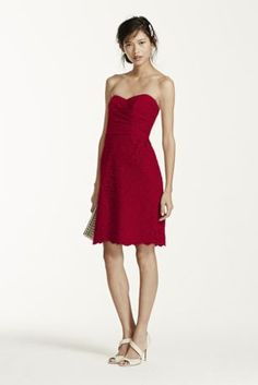 Your bridesmaids will look flawless in this feminine lace dress!  Strapless all over lace bodice features sweetheart neckline with pleated bust.  Scalloped lace hem that hits right above the knee.  Fully lined. Back zip. 52% Nylon/48% Rayon. Dry clean only.  To protect your dress, try our Non Woven Garment Bag.Also available in Extra Length as Style 2XLF15620.