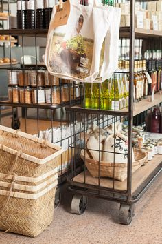 retail shelves on wheels so the space can be rearranged seasonally to mix it up