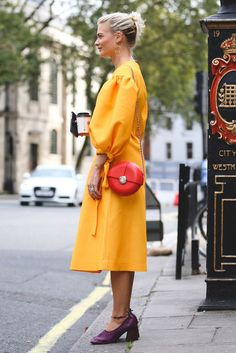 Yorange (yes, yellow/orange) is the color of the season. Here's one foolproof way to wear it, courtesy of Pandora Sykes.Rejina Pyo dress. #refinery29 http://www.refinery29.com/2016/09/123831/lfw-spring-2017-best-street-style-outfits#slide-2