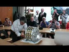 Inventor demonstrates his motor powered with permanent magnets. - YouTube