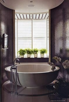 Simple and modern bathroom with a circular tub. #interiordesign #bathroomdesign #freestandingtub