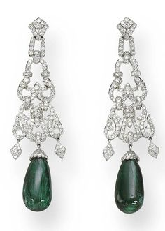 A PAIR OF EMERALD AND DIAMOND EAR PENDANTS   Each suspending a cabochon emerald drop from a circular-cut diamond flexible scrollwork motif, mounted in 18K white gold