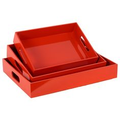 Serve snacks on movie night or add a pop of color to your nightstand with these nesting wood trays, showcasing a bold orange finish.