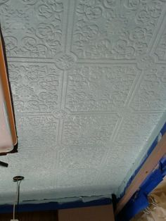 "RV Ceiling wallpaper prior to painting. Perfect solution for the ""messy"", mismatched areas on my ceiling."