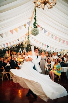 Image by Kerry Diamond - Courtney by Maggie Sottero For A Rustic Marquee Wedding In The Lake District With Groom In Military Uniform And Bridesmaids In Mismatched Pastel Wrap Dresses Images By Kerry Diamond Photography