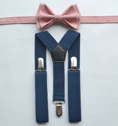 This is for the two ting bearers. Paired with white button down long sleeved shirt and navy shorts.