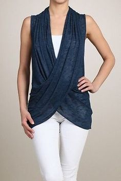 Simple sleeveless hand dyed navy top with a draped cross over bodice