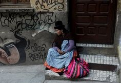 An Aymara woman rests at the witch doctor's street in La Paz, Bolivia July 31, 2015. (Photo by David Mercado/Reuters)