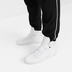 Zara WHITE HIGH TOP SNEAKERS was $59.90, now 19.99. Plain white high-top sneakers with laces. Quilted ankle and white stitching. Coarse sole detail.
