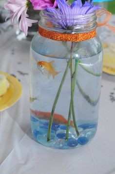 this is the closest i got to the real concept i had seen which was betta fishes in a vase with tropical flowers :)