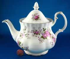 This is a Lavender Rose pattern by Royal Albert, England bone china teapot that was made England in the 1980s before production moved to Indonesia.. The pretty and elegant English bone china teapot me