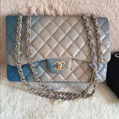 Rare Chanel Jumbo Blue Ombré degrade Lambskin Bag $3500 PayPal OnlyThis Chanel Lambskin Jumbo Flap is truly a one-of-a-kind bag. This bag is from the 2010 limited edition collection features lambskin leather that fades from light blue to pale grey, a single flap style, and a matte gold turnlock CC closure. 9.5/10 NEW CONDITION! Plz feel free to contact me at 202-812-6260 for extra picture and PP offers :) Includes: Dust bag only Origin: France Production Year: 2010 Date/Authenticity Code…