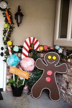Transform your front porch into a candy land gingerbread house with giant candy decorations! (Easy step-by-step tutorials with video.) Love the giant candy garland. Gingerbread Christmas Decor, Gingerbread House Designs, Candy Land Christmas, Gingerbread House Parties, Gingerbread Decorations, Candy Christmas Decorations, Christmas Yard, Christmas Crafts, House Decorations