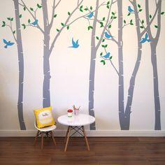 light grey trees, light bluebirds, grass green leaves