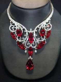 "Harry Winston 180ct Spinel THE GEMSTONE SPINEL Spinel is most famous for its deep red variety that closely resembles Ruby. These two gemstones can be very difficult to distinguish. Until the late 19th century, there was no distinction made between Ruby and red Spinel, as they look identical and are found in the same localities. Many famous old ""Rubies"" were discovered to be in fact Spinel."