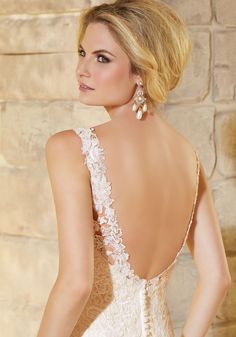 Wedding Dresses and Bridal Gowns by Morilee designed by Madeline Gardner. Lace and Embroidered Appliques on Net with a Scalloped Hemline Wedding Dress.