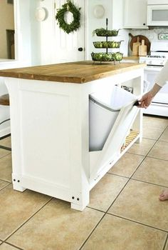 How to build a 4'x 2 1/2' kitchen island with trash storage and storage shelves. Includes sources for best finish and free downloadable build plans. #DIY #Storage