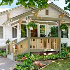 Give your home an exterior facelift by replacing worn or dated porch railings with custom wood railings topped by an overhead structure.