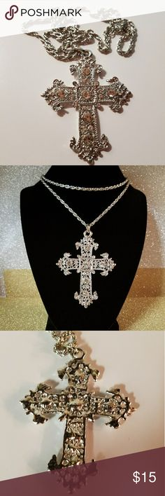 "Silvertone Cross Pendant Rhinestone Chain Necklace Beautiful shiny silver tone cross pendant on a long rope chain. Pendant is decorated all ovet with rhinestones and six big crystals. Cross with a bail measures approximately 3 1/2"" x  2 1/2"".  Chain is 28"" long + 2"" extender.  I don't know if it is silver plated or not. There is no markings/hallmarks. I am also not sure about the origin of the stones. The only thing I can tell that it is really gorgeous, shiny and sparkling. Please enlarge…"