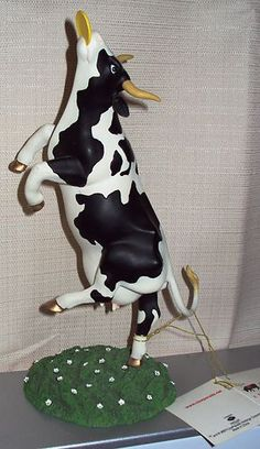 2001 Cows on Parade --  Daisy's Dream -cow Frisbee Figurine. I have this and a couple of others.