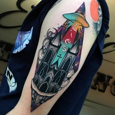 Surrealist church and UFO tattoo on the left upper am.