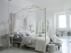 statement pieces above a bed   Tilly Canopy bedstead, £649, BHS