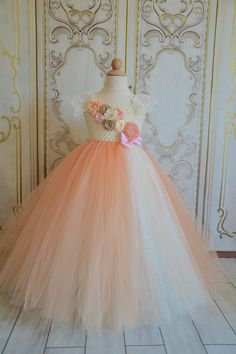 This flower girl dress is made with an ivory crochet tutu top and two ivory lace shoulder straps tying into the back of the dress in a bow.