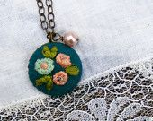 The Ingrid:  embroidered pendant with flowers on turquoise background and pearl