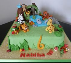 I really enjoyed making these cute animals for this jungle animals birthday cake. Lions, tigers, giraffe, zebra, monkeys, hippo, crocodile – it has them all. And a pond, trees and everything.   Jungle Animals Birthday Cake