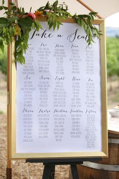 Gold frame, black calligraphy, seating chart, greenery // Amira Gray Photography