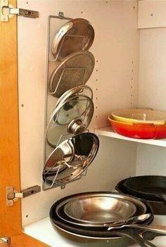Como organizar tapas de ollas