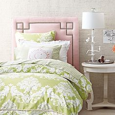 Love that there's a pink headboard but not a lot of pink in the bedding.  also love the pink/green combo.