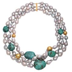 Grey Pearl & Turquoise Necklace Three strands of very large natural pearls with rare turquoise rocks and 22kt yellow-gold beads.  Overall length: 27""