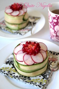 "Swedish Sandwich Cake – layers of bread, cheese, mustard/mayonnaise, meat, etc. Cover the outside with dip or a thick sauce (like a ""frosting""). Peeled strips of cucumber wrapped around, topped with radish and pomegranate seeds"