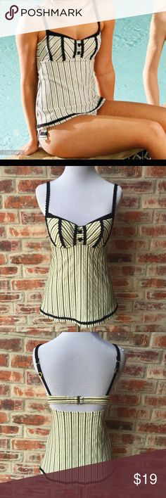 Betsey Johnson Black Cream Tankini Top Sz Small This tankini top by Betsey Johnson is in great condition. It has only been worn a few times. It's a size small and looks adorable on. It goes great with solid black bikini bottoms. Betsey Johnson Swim