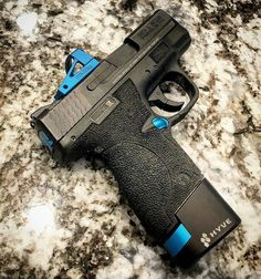 got his slide back from machining at and mounted his custom blue RMS-C, on the M&P Shield… Airsoft Guns, Shotguns, Weapons Guns, Guns And Ammo, Firearms, Tactical Guns, Revolvers, Smith And Wesson Shield, Smith N Wesson