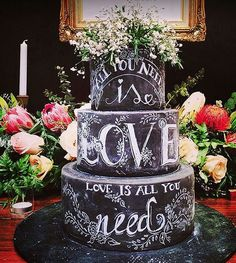 Take chalkboard details to the next level by including them in your wedding cake. This non-traditional cake skips the white buttercream in favor of black fondant and a Beatles quote.